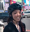 Smiling woman wearing a helmet.